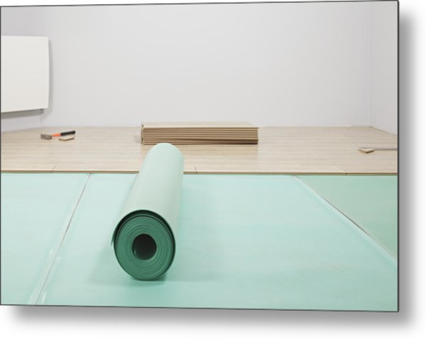 Laying A Floor. A Roll Of Underlay Or Metal Print by Magomed Magomedagaev
