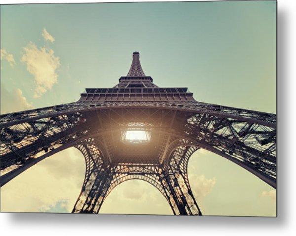 Light Shining Through Eiffel Tower Metal Print