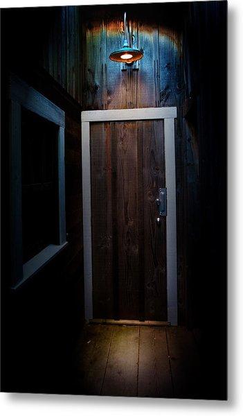 Lighted Doorway Metal Print by Raymond Potts