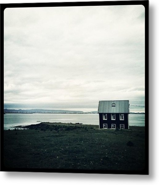 Little Black House By The Sea Metal Print