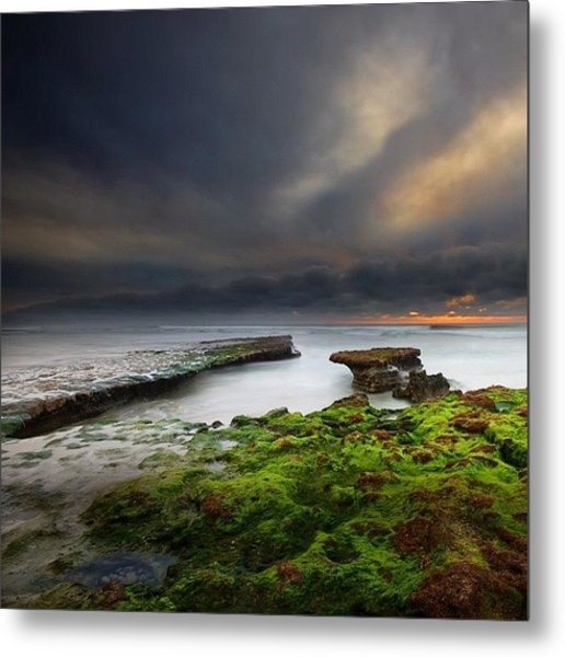 Long Exposure Of A Stormy Sunset At A Metal Print by Larry Marshall