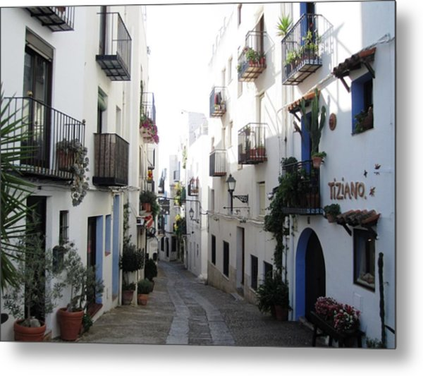 Lovely Narrow Street And Balconies Decorated With Plants In Peniscola Spain Metal Print