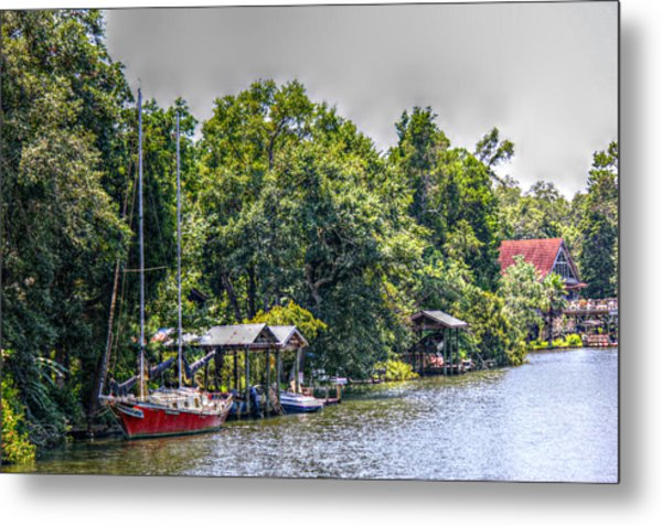 Magnolia River With A Red Sailboat Metal Print