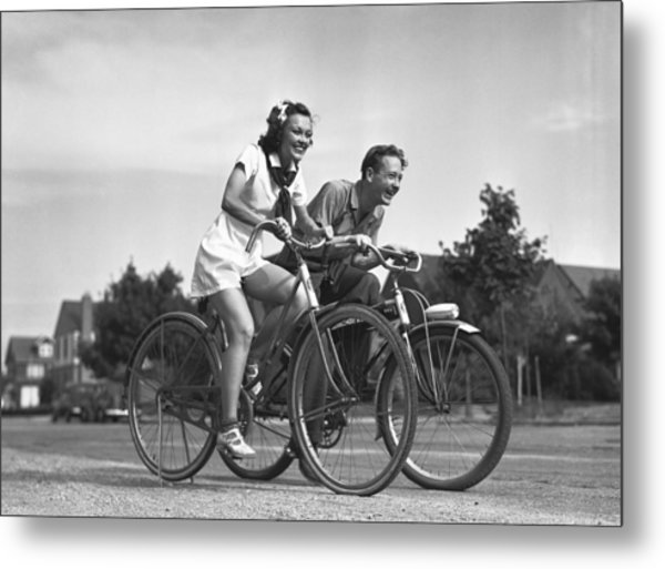 Man And Woman Riding Bicycles, (b&w), Metal Print by George Marks
