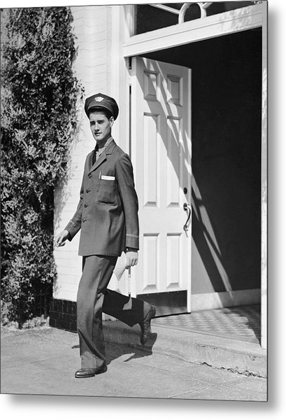 Man In Uniform Walking Out Door Metal Print by George Marks