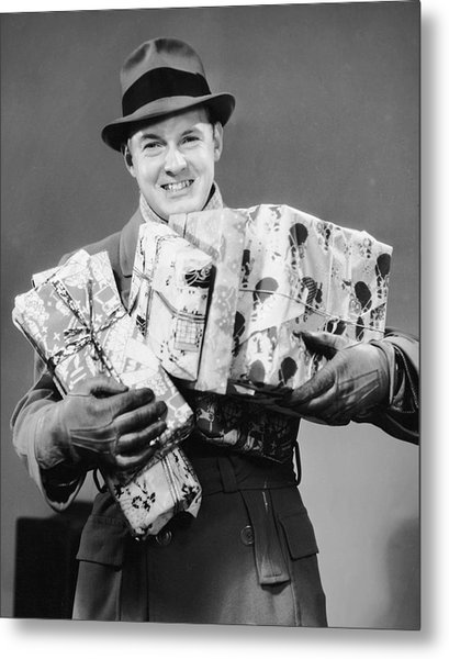 Man With Coat, Gloves And Hat Carrying Christmas Gifts Metal Print by George Marks