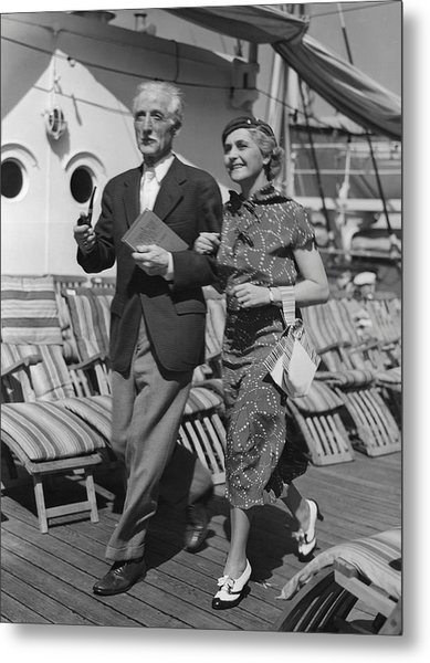 Mature Couple On Deck Of Boat Metal Print by George Marks