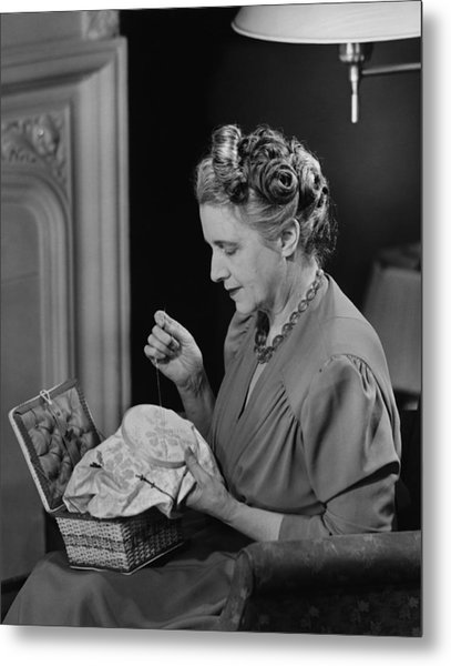 Mature Woman Sitting In Living Room, Doing Needlepoint, (b&w) Metal Print by George Marks