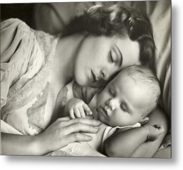 Mother Holding Infant In Bed Metal Print by George Marks