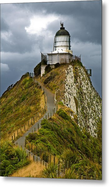 Nugget Point Light House And Dark Clouds In The Sky Metal Print