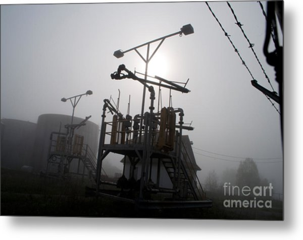 Platforms And Tanks At Petrocor In The Fog Metal Print by Gary Chapple