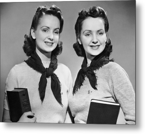 Portrait Of Teenaged Twin Girls Holding Books Metal Print by George Marks