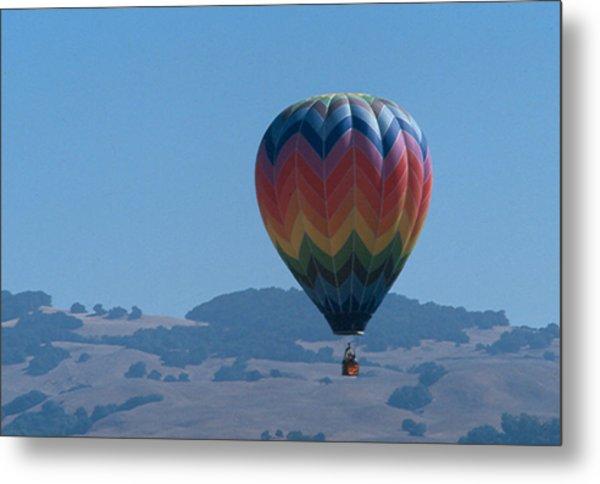 Rainbow Balloon Over Hills Metal Print