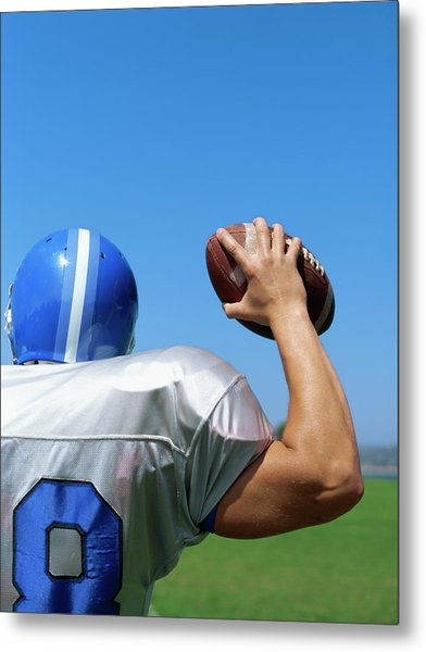 Rear View Of A Football Player Throwing A Football Metal Print by Stockbyte