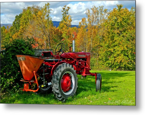 Red Tractor And Green Grass Metal Print