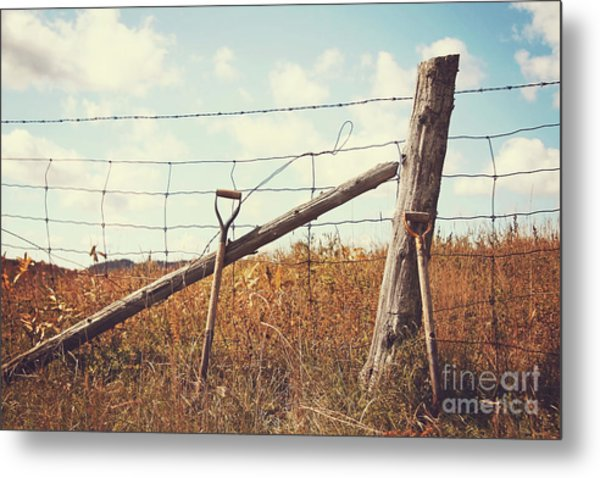 Shovels Leaning Against The Fence Metal Print