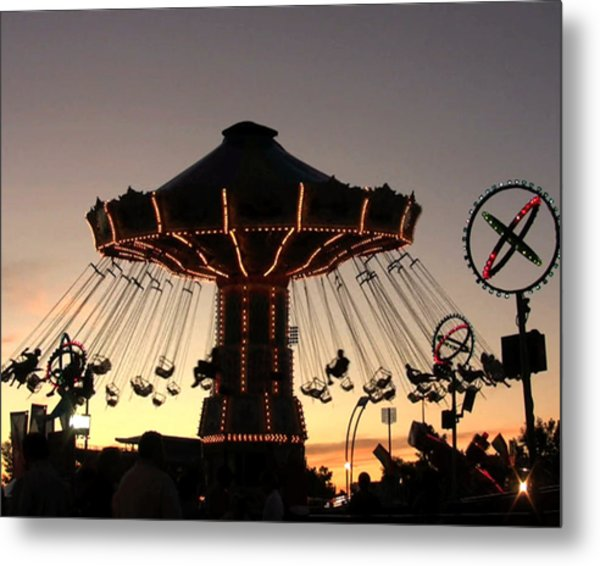 Silhouetted Amusement Ride Metal Print by Kim French
