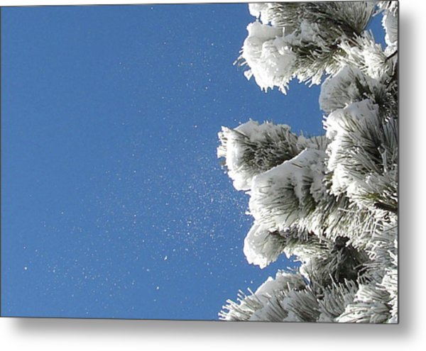 Snow Flakes Against A Blue Sky Metal Print