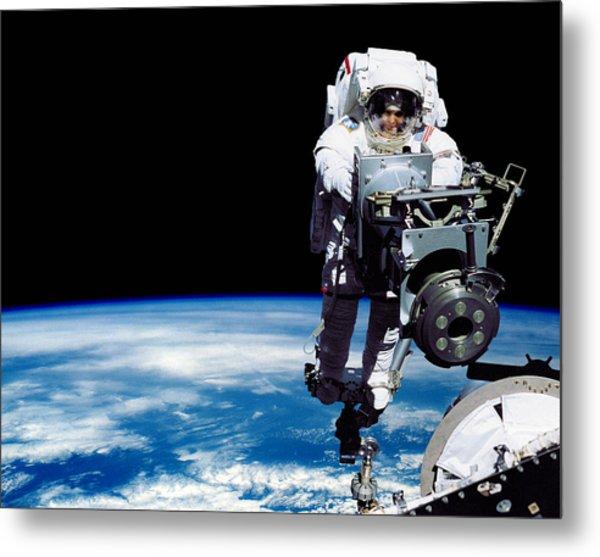 a 70 kg astronaut in space walking outside - photo #8