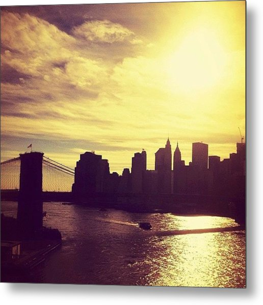 Sunset Over The New York City Skyline And The Brooklyn Bridge Metal Print