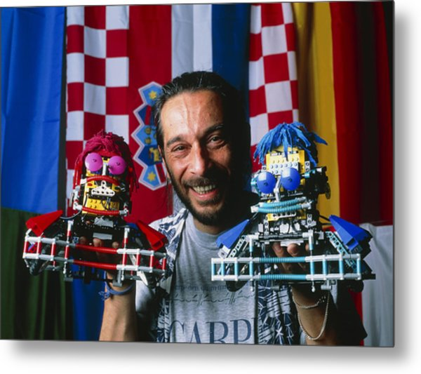 Technician With Lego Footballers At Robocup-98 Metal Print by Volker Steger