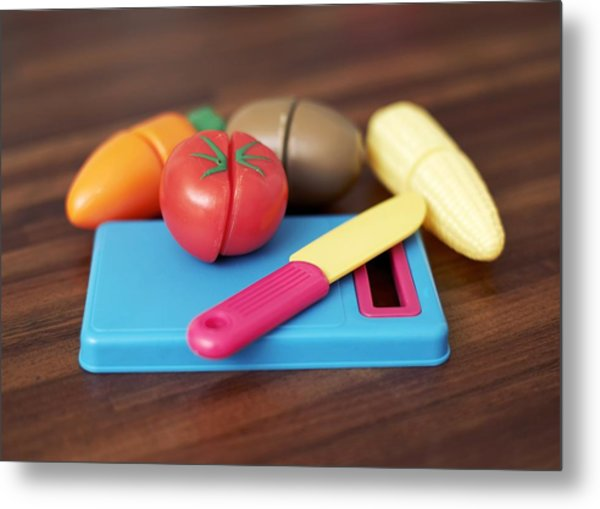 Toy Vegetable Chopping Board Metal Print by Ian Boddy