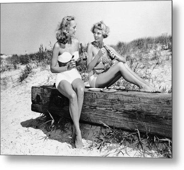 Two Women Drinking Soda On Beach Metal Print by George Marks