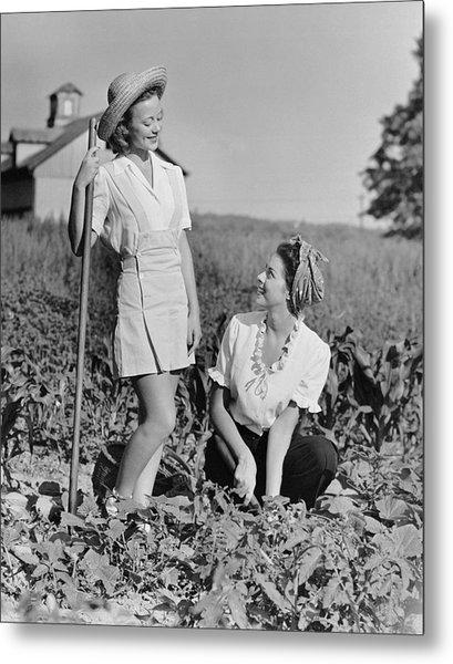 Two Women Gardening In Field Metal Print by George Marks