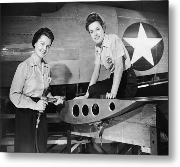 Two Women Working On Airplane Metal Print by George Marks