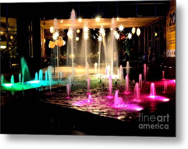 Water Fountain With Stars And Blue Green With Pink Lights Metal Print