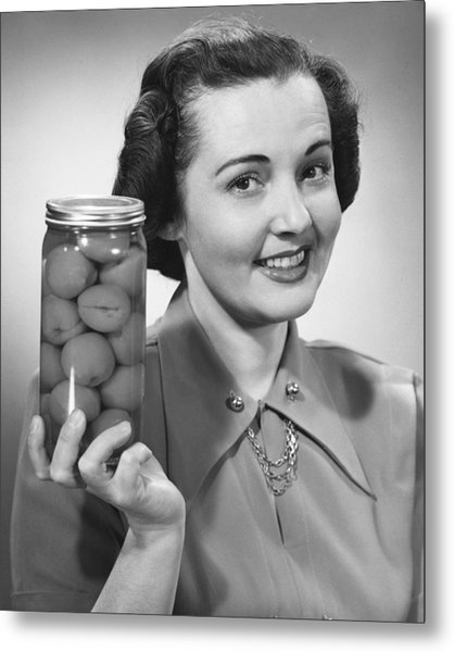 Woman Holding Jar Of Fruit Metal Print by George Marks