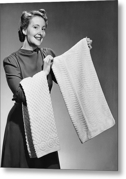 Woman Holding Up Towels Metal Print by George Marks