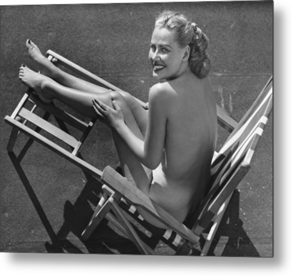 Woman In Beach Chair Metal Print by George Marks