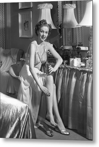 Woman In Bedroom Putting On Lotion Metal Print by George Marks