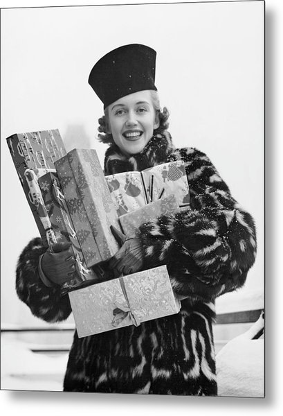 Woman In Fur Coat Holding Christmas Gifts Metal Print by George Marks