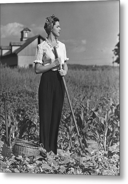 Woman In Vegetable Garden Metal Print by George Marks