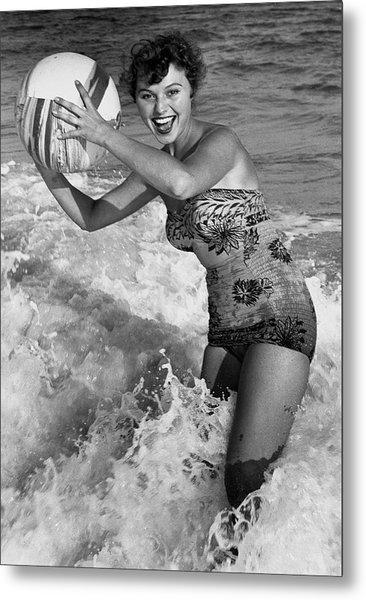 Woman In Water W/beachball Metal Print by George Marks