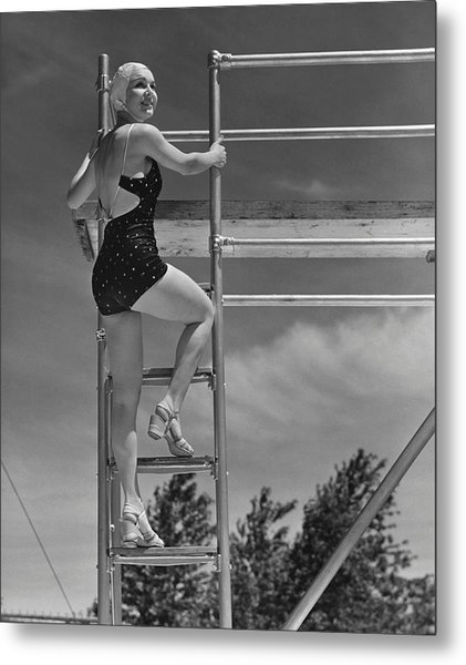 Woman On Diving Board Metal Print by George Marks