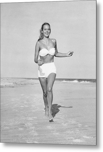 Woman Running On Beach Metal Print by George Marks