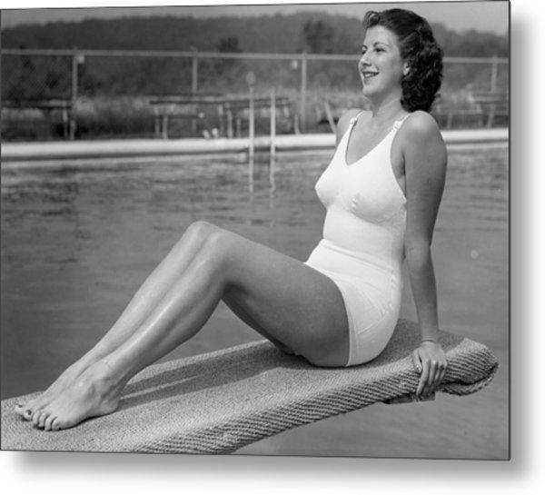 Woman Sitting On Divingboard Metal Print by George Marks