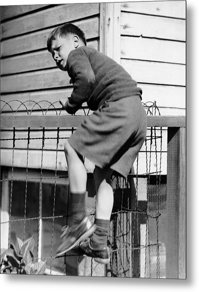 Young Boy Climbing Fence Metal Print by George Marks