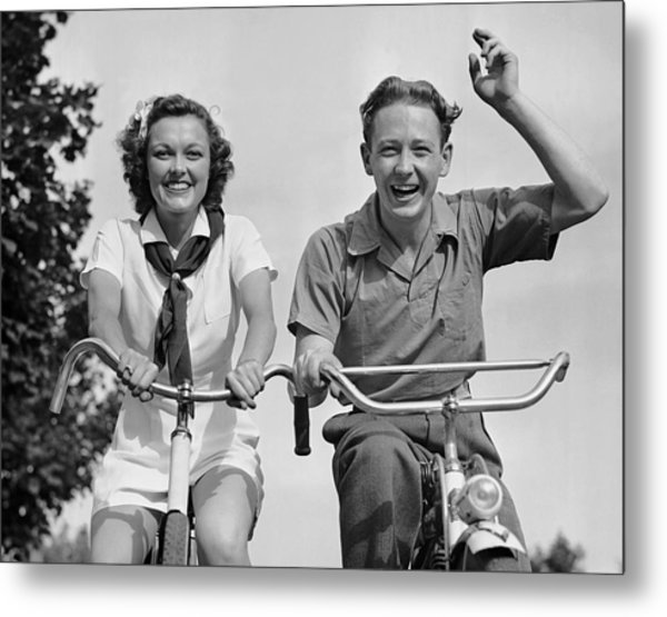 Young Couple Riding Bicycles Metal Print by George Marks