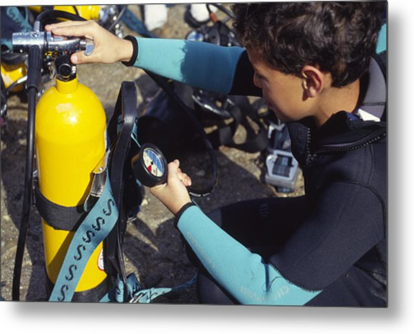 Young Scuba Diver Checking Kit Metal Print by Alexis Rosenfeld
