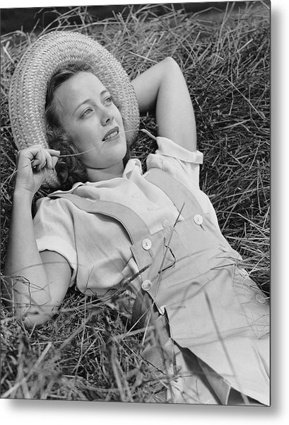 Young Woman Laying In Hay Thinking Metal Print by George Marks