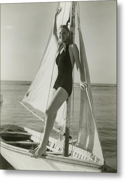 Young Woman Posing On Sailboat Metal Print by George Marks