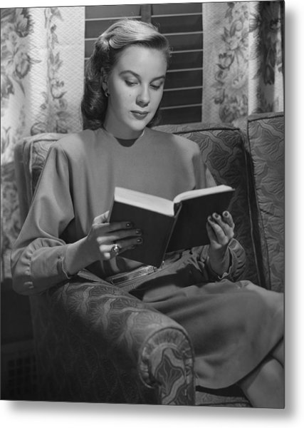 Young Woman Sitting On Sofa, Reading Book, (b&w) Metal Print by George Marks