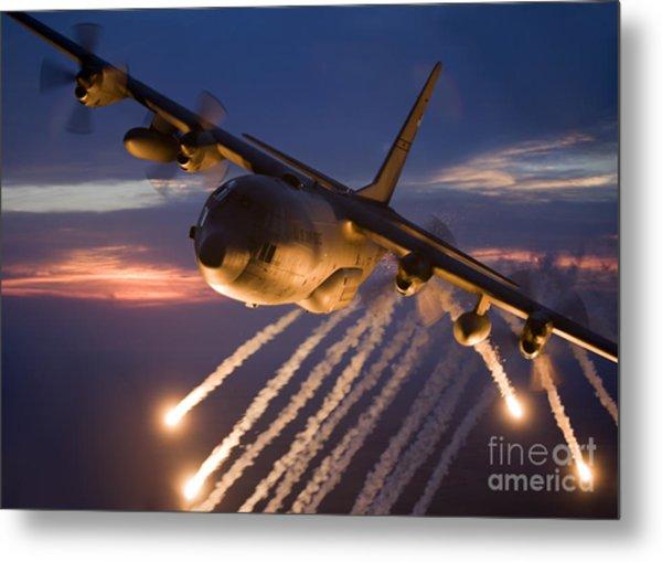 A C-130 Hercules Releases Flares Metal Print