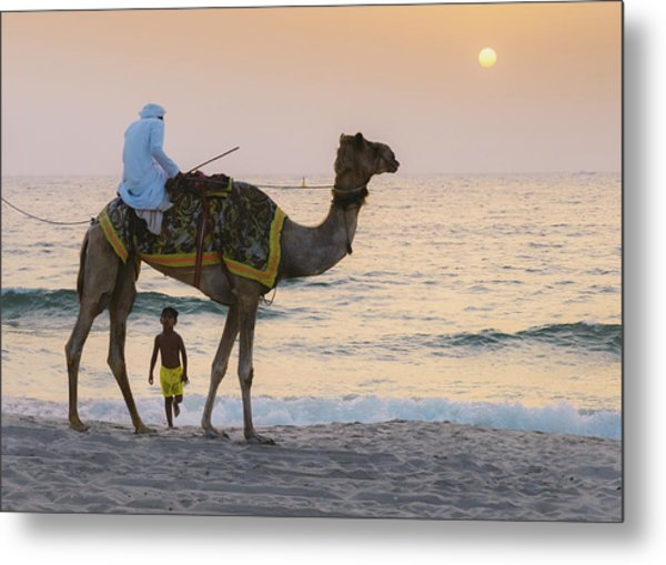 Little Boy Stares In Amazement At A Camel Riding On Marina Beach In Dubai, United Arab Emirates -  Metal Print