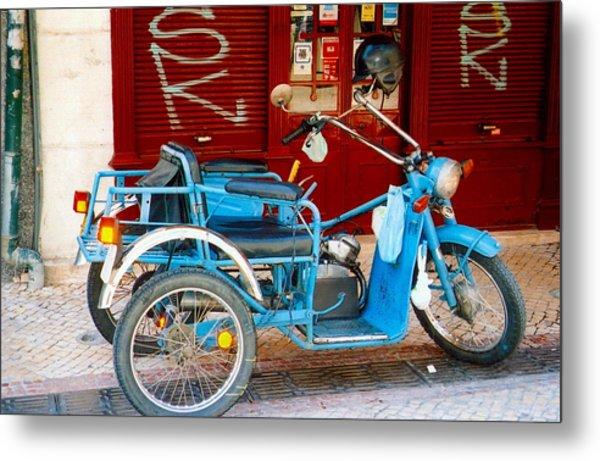 Portuguese Wheels Metal Print by Andrea Simon