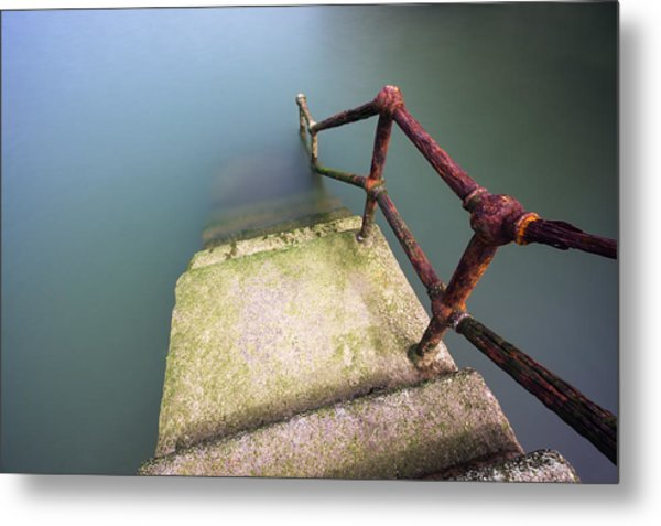Rusty Handrail Going Down On Water Metal Print